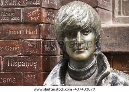 LIVERPOOL, UK. JUNE 09, 2016: Portrait of statue of John Lennon at entrance to The Cavern Club, on Mathew Street, where The Beatles played their first concert.