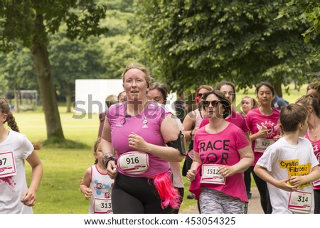 Liverpool, UK - June 26, 2016: Race for Life sponsored fun run for British charity Cancer Research UK. Groups and Family undertake their run or walk - Editorial - stock photo