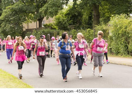 Liverpool, UK - June 26, 2016: Race for Life sponsored fun run for British charity Cancer Research UK.  The race is on, Groups and Family undertake their run or walk - Editorial - stock photo