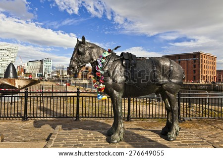LIVERPOOL, UK - MAY 3, 2015: The Working Horse Monument 'Waiting' by Judy Boyt commemorates 250 years of service of the working horses of Liverpool. Hauling goods between the docks and warehouses. - stock photo