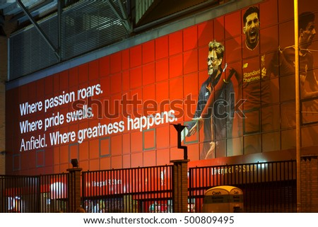 LIVERPOOL UK, 17th OCTOBER 2016. Liverpool Football Club's new giant mural for the 2016/17 season at the Kop end of the stadium lit up at night