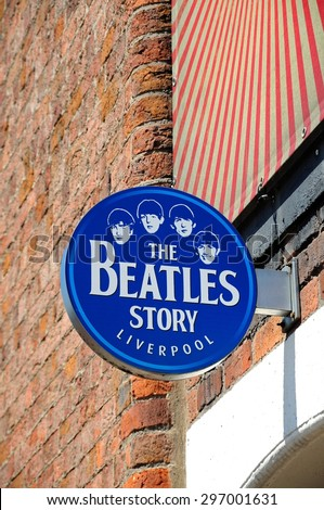 LIVERPOOL, UNITED KINGDOM - JUNE 11, 2015 - Sign on the outside of The Beatles Story building at Albert Dock, Liverpool, Merseyside, England, UK, Western Europe, June 11, 2015. - stock photo