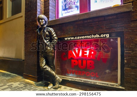 LIVERPOOL, UNITED KINGDOM - OCTOBER 11, 2014:  John Lennon statue outside the historic Cavern Club on Matthew Street in Liverpool seen at night. - stock photo