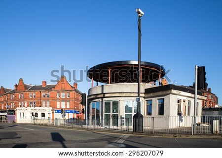 LIVERPOOL, UNITED KINGDOM - OCTOBER 12, 2014:  View of famous roundabout bus station on Penny Lane in Liverpool, UK.  - stock photo