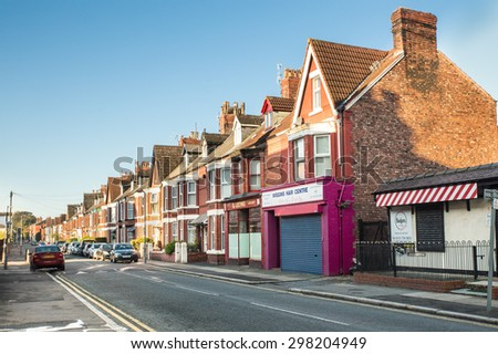 LIVERPOOL, UNITED KINGDOM - OCTOBER 11, 2012:  View of row of houses along historic Penny Lane made famous by the Beatles in 1967.  - stock photo