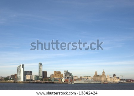 Liverpool Waterfront with the Royal Navy Ship Ark Royal berthed on the docks showing the famous Liverbirds - stock photo