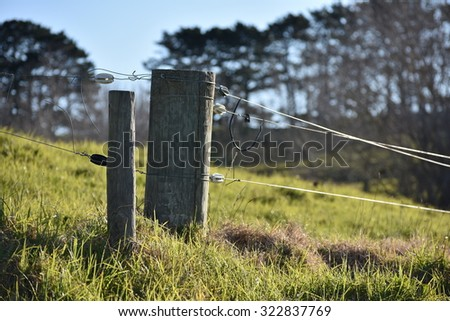 Livestock electric fence â?? a typical view of New Zealand countryside. - stock photo