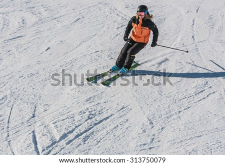 LIVIGNO, ITALY - JANUARY 28, 2015: Skier on the slope of  Ski resort Livigno, Lombardi, January 28, 2015, Italy. Livigno is  developing ski resort in northern Italy