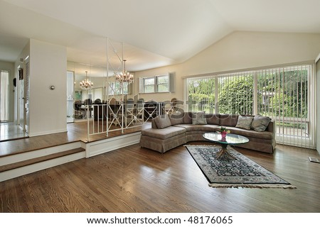 Living and dining room in split level suburban home - stock photo