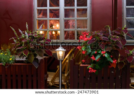 Living area; a side walk cafe decorated with flowers - stock photo