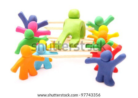 living bridge - teamwork concept with plasticine puppets. educational cooperation training building trust and responsibility - isolated on white - stock photo