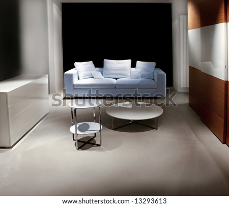 Living room at night with sofa and table - stock photo