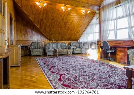 Living room attic wood interior with carpet - stock photo
