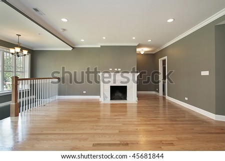 Living room in luxury condo with white railing - stock photo