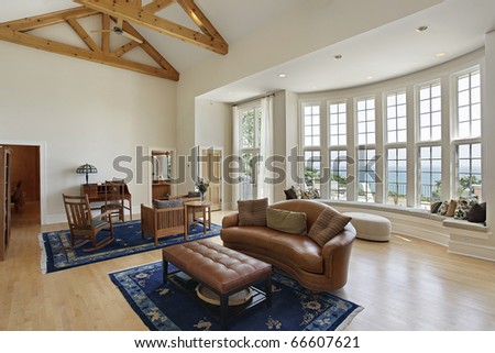 Living room in luxury home with curved windows - stock photo