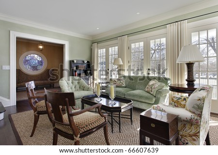 Living room in luxury home with foyer view - stock photo