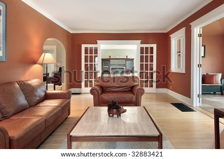 Living room in luxury home with orange walls - stock photo