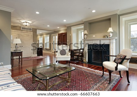 Living room in luxury home with view into foyer - stock photo