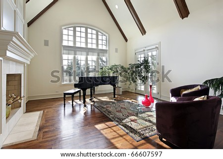 Living room in luxury home with wood ceiling beams - stock photo