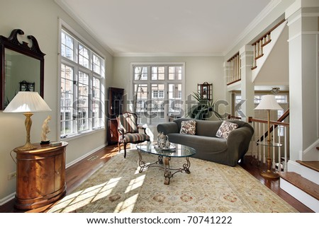 Living room in modern townhouse with foyer view - stock photo