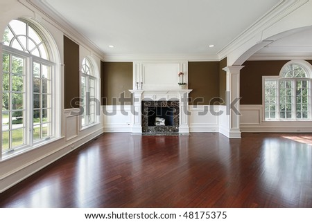 Living room in new construction home with cherry wood flooring - stock photo