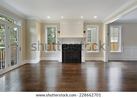Living room in new construction home with fireplace - stock photo