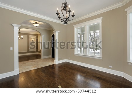 Living room in new construction home with foyer view - stock photo