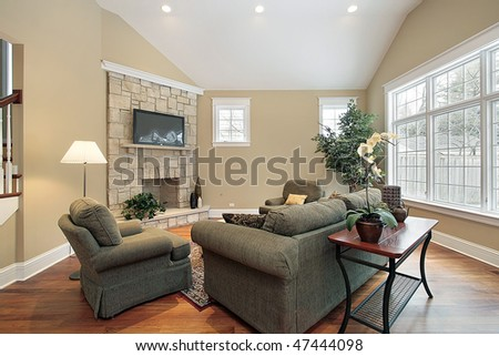Living room in new construction home with stone fireplace