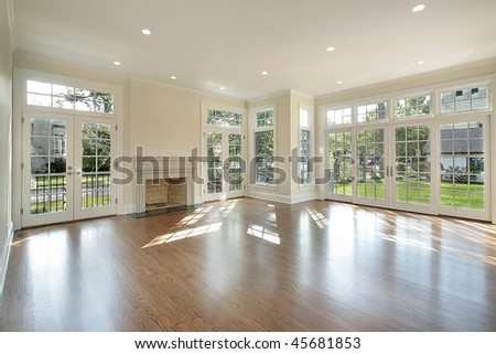 Living room in new construction home with wall of windows - stock photo