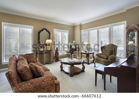 Living room in traditional home with white carpeting - stock photo