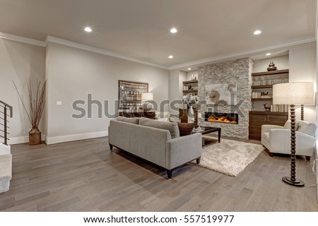 Living Room Interior In Gray And Brown Colors Features Gray Sofa Atop Dark  Hardwood Floors Facing
