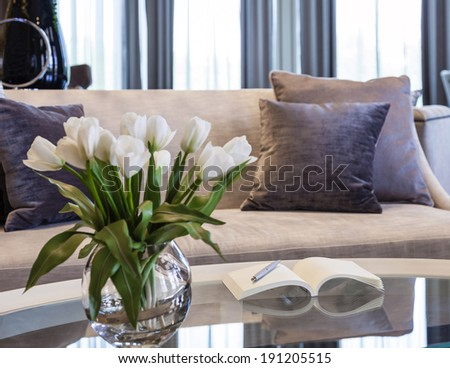 Living room interior modern style with pillows book and flower - stock photo