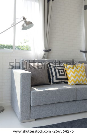 living room interior with graphic pattern pillows - stock photo
