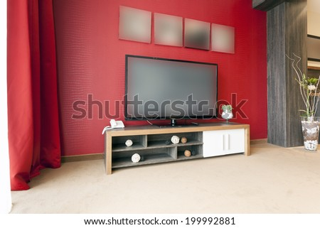Living room interior with large lcd tv - stock photo