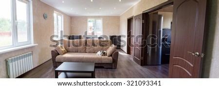 living room of a country house. Dog sleeping on the couch - stock photo