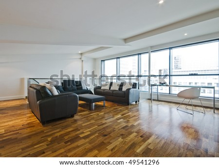 living room of a penthouse placed in loft - stock photo