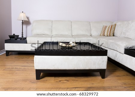 living room setting with sectional couch and coffee table - stock photo
