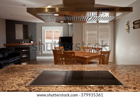 Living room viewed through the kitchen hood - stock photo