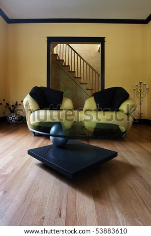 Living room with a couch and a coffee table - stock photo