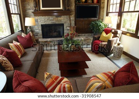 Living room with a fireplace and modern decor. - stock photo
