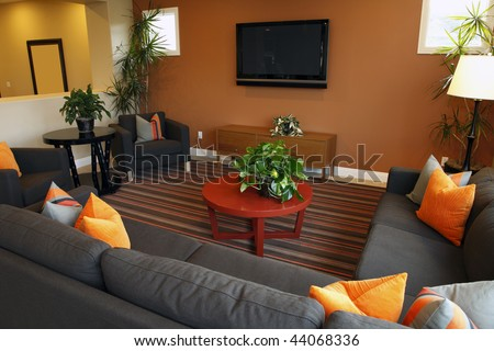 Living room with an HDTV and modern decor. - stock photo