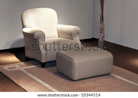 Living Room With Armchair And Leg Rest