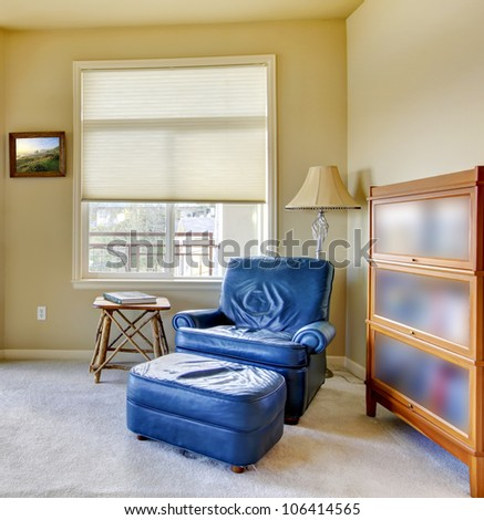 Living room with blue chair and book shelve. - stock photo
