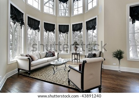 Living room with curved windows - stock photo