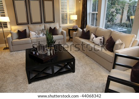 Living room with designer decor and modern furniture. - stock photo