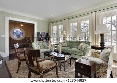 Living room with doors to deck and foyer view - stock photo