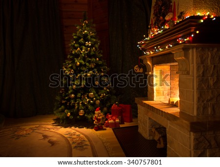 Living room with fireplace and decorated Christmas tree - stock photo