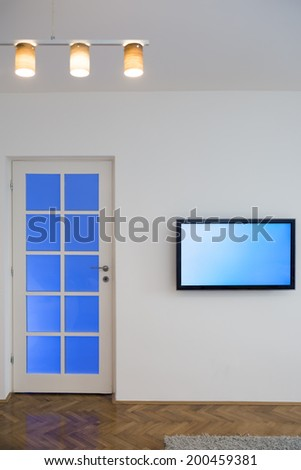 Living room with flat TV and chandelier - stock photo