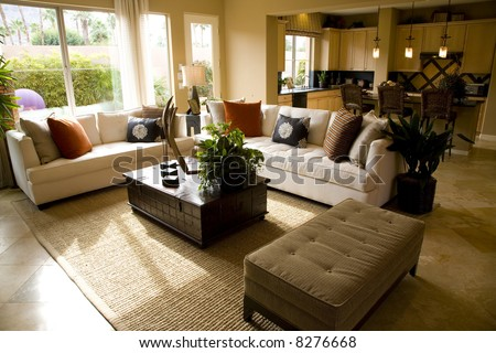Living room with kitchen in the background. - stock photo