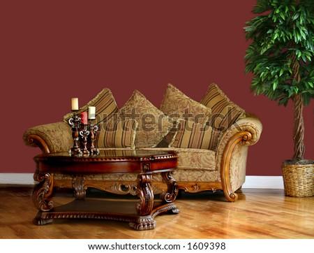Living room with minimal furnishings; blank wall - stock photo